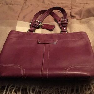 Purplish/Burgundy Coach handbag